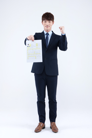 Asian man in suit with resume isolated on white Stock Photo