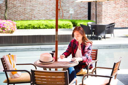 Asian beautiful woman taking a rest at coffee shop