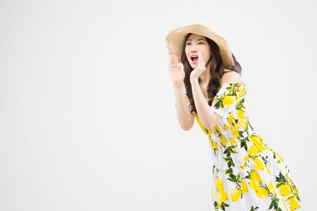 Asian woman in bikini calling isolated on white Stock Photo