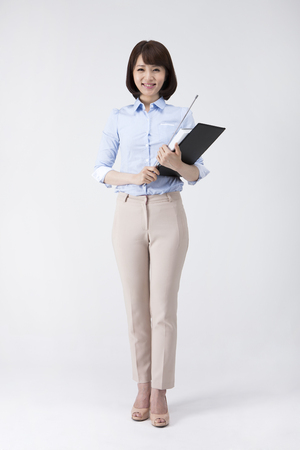 Portrait of Asian female teacher holding document and teaching stick isolated on white background