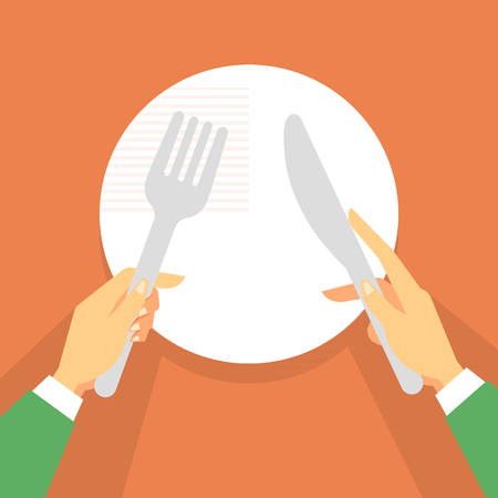Hand holding forks and knife in plate