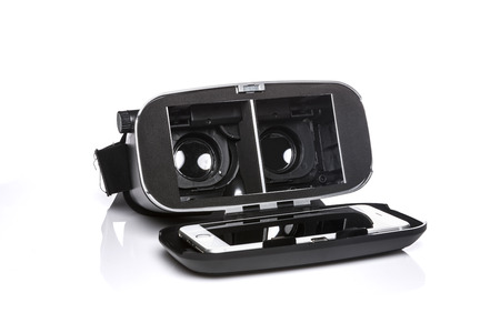 A VR goggle with phone stands on white backgroud.