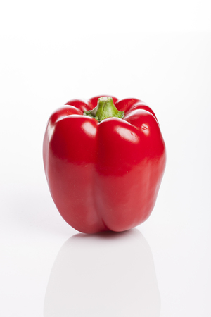 A ripe red paprika isolated on white background Stock Photo