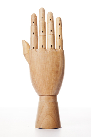 A wooden ball-jointed right hand isolated on white background shows a palm backward with fingers spread.