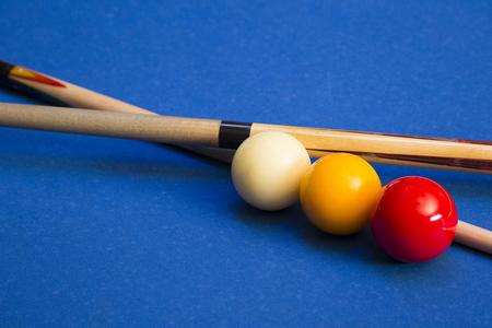 Play billiards on the pool table. 021
