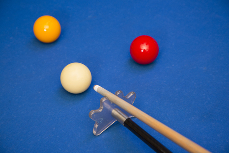 Play billiards on the pool table. 049