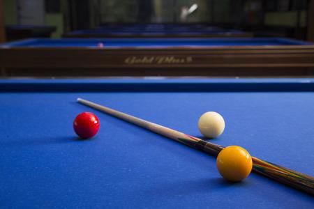 Play billiards on the pool table. 065