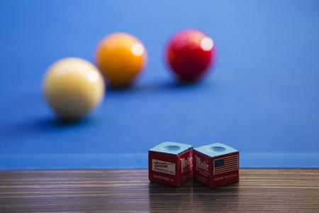 Play billiards on the pool table. 027