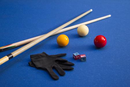 Play billiards on the pool table. 007