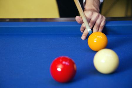 Play billiards on the pool table. 031