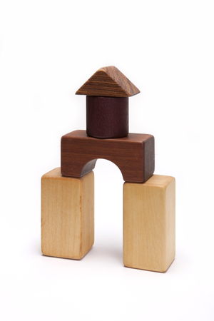 A wooden block building isolated on white background