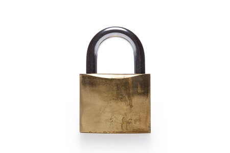 A metal lock isolated on white background stands. Reklamní fotografie