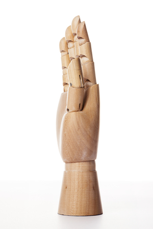 A wooden ball-jointed right hand isolated on white background shows a palm to the side with fingers spread.