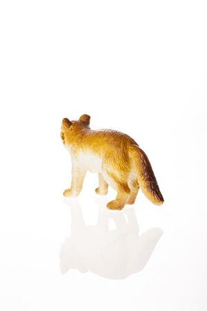 A fox figure isolated on white background Stock Photo