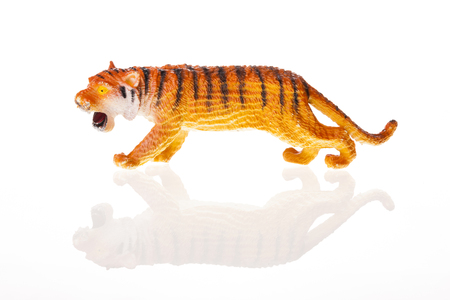 A tiger figure isolated on white background