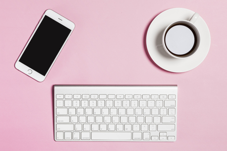 Business objects on pink background