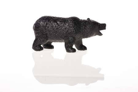 A black bear figure isolated on white background