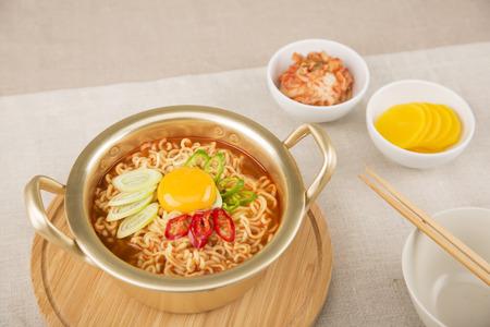 Food photo - famous snack and street foods in Korea. Stir-fried rice cake, Korean sausage, Kimbap, Ramen, Dumplings and cold bean-soup noodles.