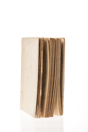 A vintage book isolated on white background