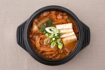 Delicious Korean food - kind of noodles, soup with rice and side dish with fish on the table. 076