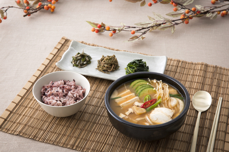 Delicious Korean food - kind of many food, soup with rice and side dish on the table. 스톡 콘텐츠
