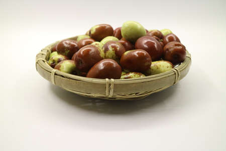 jujube in wood basket isolated on white background_005