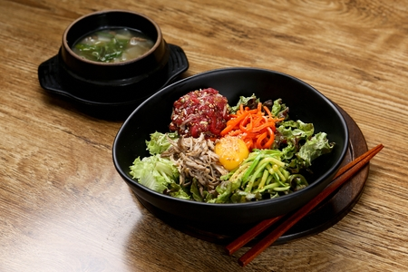 Korean food collection photo_Beef Tartare Bibimbap, mixed White rice in bowl top view, vegetables and hot pepper paste. Its a healthy dish., White rice in bowl top view mixed with beef tartare, vegetables, and red pepper paste. 21 Stock Photo
