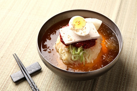 Cold and spicy Korean wheat noodles, milmyeon with chopsticks