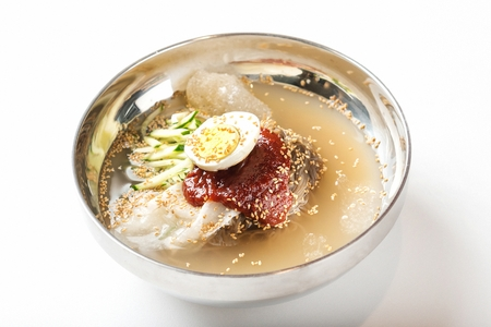 Korean food Cold Noodles with vegetables, Mul-naengmyeon, top view