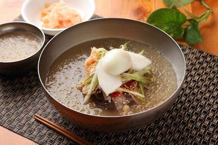 Korean food Cold Noodles with meat and vegetables, Mul-naengmyeon
