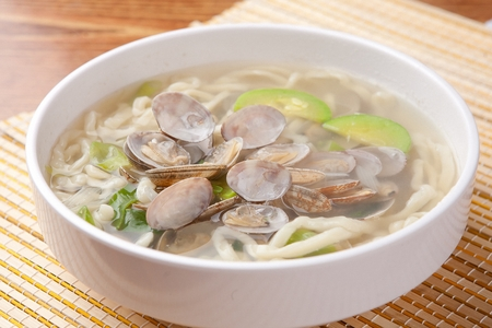 Korean handmade noodle kalguksu with manila clams, close-up shot