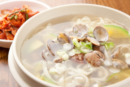 Korean handmade noodle kalguksu with manila clams, close-up shot