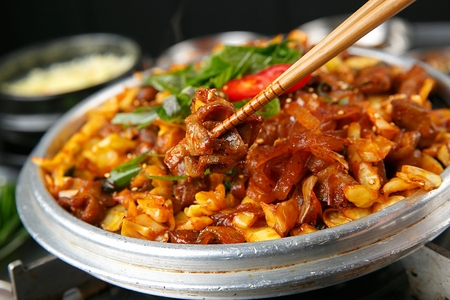 Spicy Korean food pork intestines stir-fried with vegetables and spicy sauce