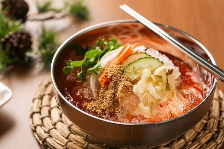 Spicy and cold Korean noodles with kimchi, close-up shot Stok Fotoğraf