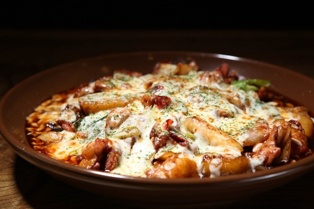 Spicy Korean style braised chicken covered in cheese