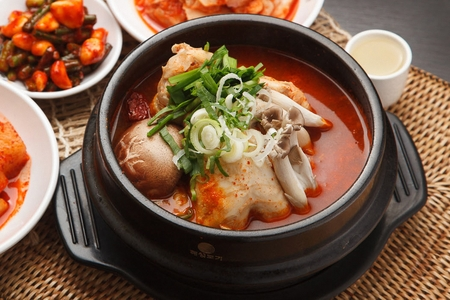 Korean cuisine Samgae Tang, ginseng chicken soup in spicy broth Stock Photo
