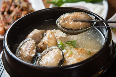 Korean cuisine samgaetang, ginseng chicken soup with abalones Stock Photo