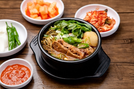 Spicy hangover soup with vegetables and pork ribs, Korean cuisine Haejangguk