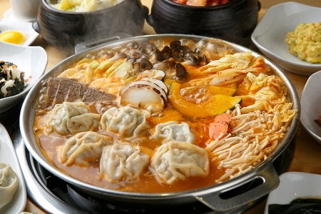 Boiling dumplings hot pot with vegetables and meat Stock Photo