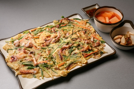 Korean pancake, pajeon with seafood and green onion leeks, Korean cuisine Jeon