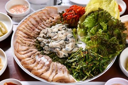 Korean cuisine bossam, boiled pork served with oysters