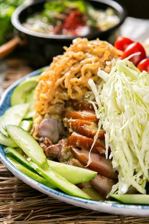 Korean cuisine naengche jokbal, boiled pigs' feet served with cold vegetables Stock fotó