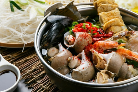 Korean style whelk soup with assorted seafoods Stock Photo