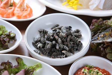 Korean side dishes with marsh snail