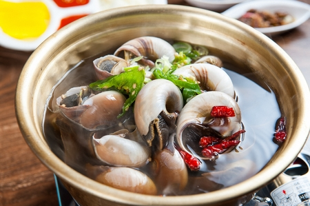 Korean style whelk soup Stock Photo