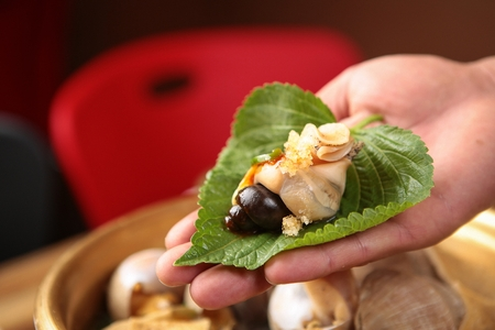 whelk on perilla leaf Stock Photo