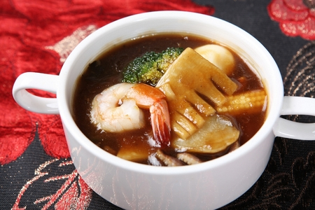 Seafood scored rice stew Stock Photo