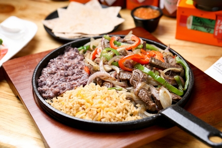 grilled meat served as a taco on a flour, Mexican cuisine Fajitas