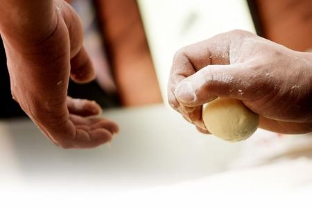 Mashed potatos and stir-fried meat fried into balls