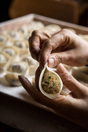 making round dumplings using hands
